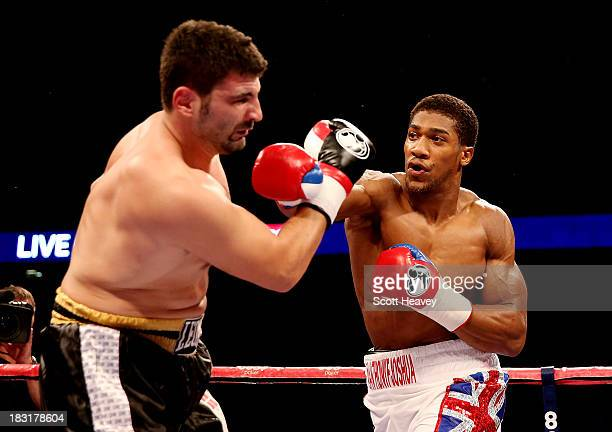 Anthony Joshua catches Emanuele Leo during their Heavyweight bout at O2 Arena on October 5 2013 in London England