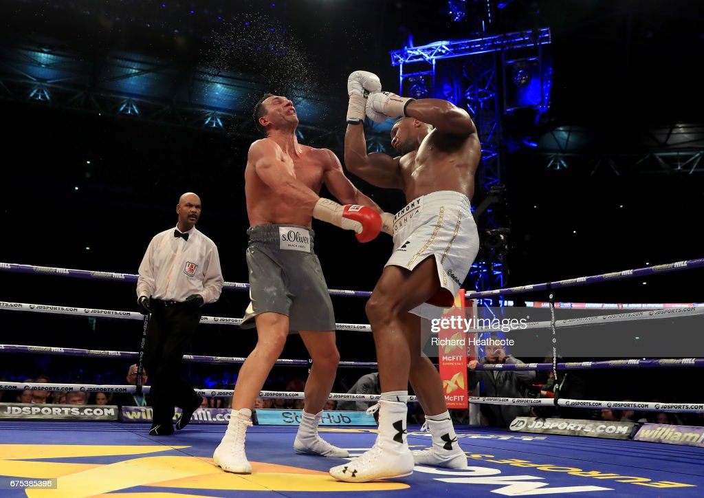 Anthony Joshua (White Shorts) catches Wladimir Klitschko (Grey Shorts) with a right hand upper cut in the 11th round of their IBF, WBA and IBO Heavyweight World Title bout at Wembley Stadium on April 29, 2017 in London, England.