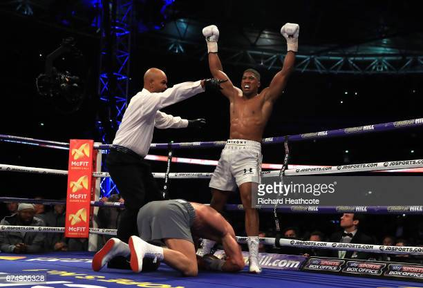 Anthony Joshua celebrates as Wladimir Klitschko lays on the floor during the IBF WBA and IBO Heavyweight World Title bout at Wembley Stadium on April...