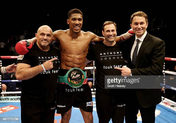 Anthony Joshua celebrates his victory over Denis Bakhtov during their Vacant WBC International Heavyweight Championship bout at O2 Arena on October...