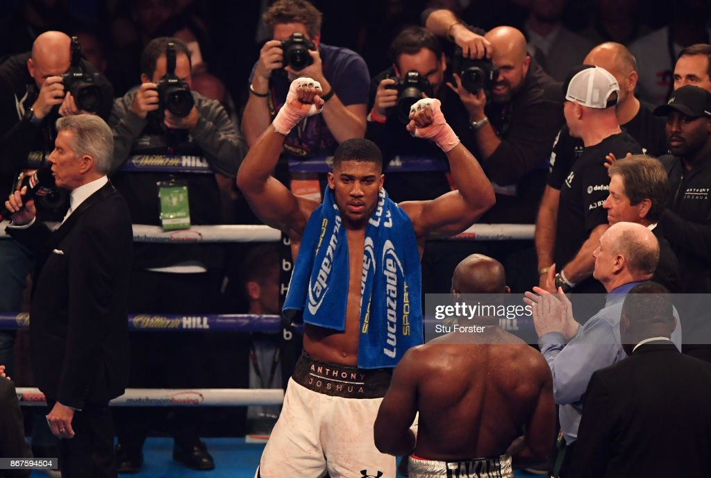 Anthony Joshua celebrates victory after a 10th round stoppage during the IBF, WBA & IBO Heavyweight Championship contest against Carlos Takam at Principality Stadium on October 28, 2017 in Cardiff, Wales.