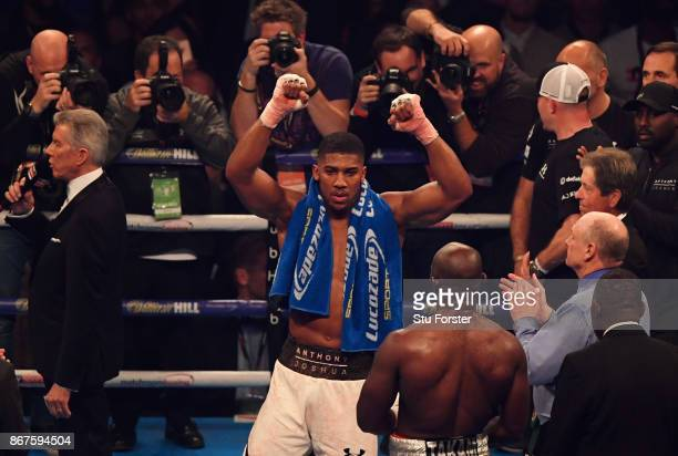 Anthony Joshua celebrates victory after a 10th round stoppage during the IBF WBA IBO Heavyweight Championship contest against Carlos Takam at...