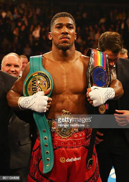 Anthony Joshua celebrates victory over Dillian Whyte with his belts after the British and Commonwealth heavyweight title contest at The O2 Arena on...
