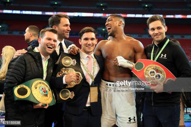 Anthony Joshua celebrates victory with his management team including manager Freddie Cunningham and promoter Eddie Hearn after the IBF WBA and IBO...