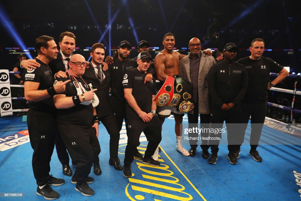 Anthony Joshua celebrates victory with his team after the IBF, WBA & IBO Heavyweight Championship contest against Carlos Takam at Principality Stadium on October 28, 2017 in Cardiff, Wales.