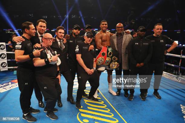 Anthony Joshua celebrates victory with his team after the IBF WBA IBO Heavyweight Championship contest against Carlos Takam at Principality Stadium...