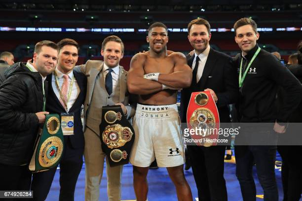 Anthony Joshua celebrates with his management team after victory over Wladimir Klitschko in the IBF WBA and IBO Heavyweight World Title bout at...