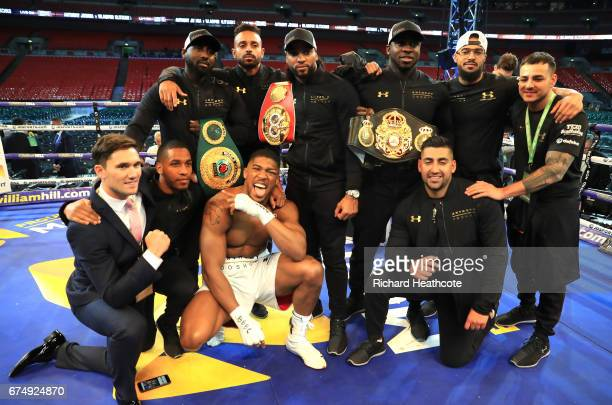 Anthony Joshua celebrates with his team after victory over Wladimir Klitschko in the IBF WBA and IBO Heavyweight World Title bout at Wembley Stadium...