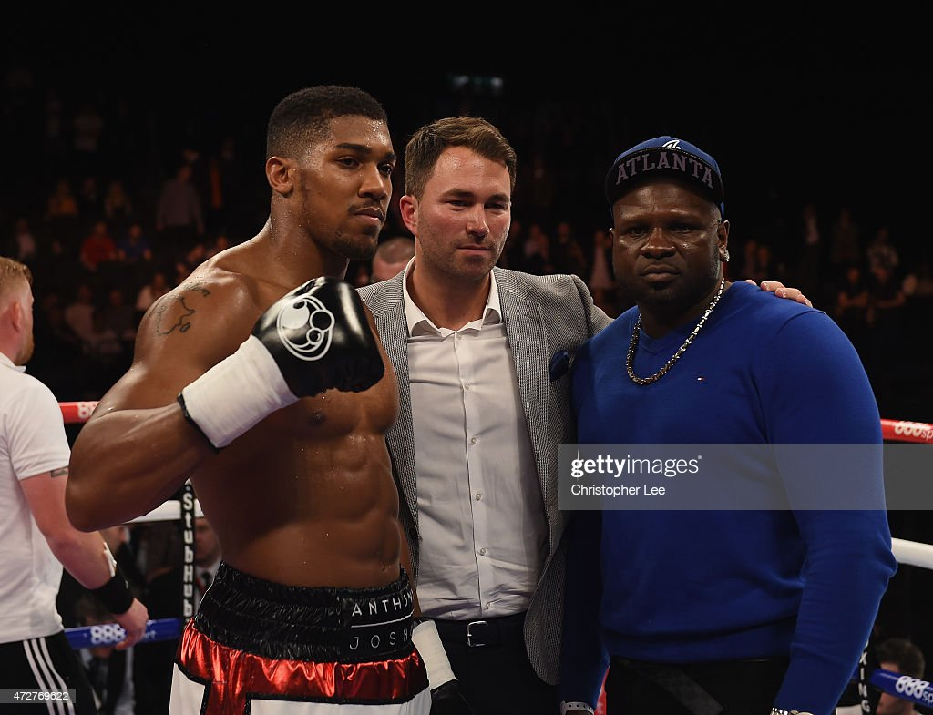 Anthony Joshua Eddie Hearn and Kevin Johnson pose for the cameras during Resurrection Fight Night at Barclaycard Arena on May 9 2015 in Birmingham...
