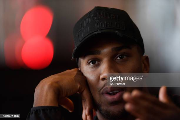 Anthony Joshua faces the media during a media opportunity ahead of his World Heavyweight title clash against Kubrat Pulev at Principality Stadium on...