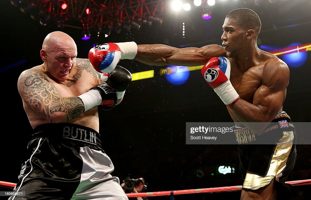 <a gi-track='captionPersonalityLinkClicked' href=/galleries/search?phrase=Anthony+Joshua&family=editorial&specificpeople=8598922 ng-click='$event.stopPropagation()'>Anthony Joshua</a> in action with Paul Butlin during their Heavyweight bout at Motorpoint Arena on October 26, 2013 in Sheffield, England.