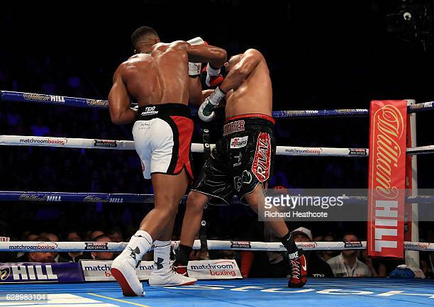 Anthony Joshua knocks down Eric Molina of the United States in their IBF World Heavyweight Championship fight at Manchester Arena on December 10 2016...