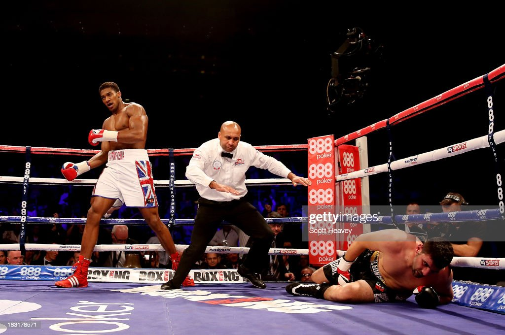 <a gi-track='captionPersonalityLinkClicked' href=/galleries/search?phrase=Anthony+Joshua&family=editorial&specificpeople=8598922 ng-click='$event.stopPropagation()'>Anthony Joshua</a> knocks out Emanuele Leo during their Heavyweight bout at O2 Arena on October 5, 2013 in London, England.