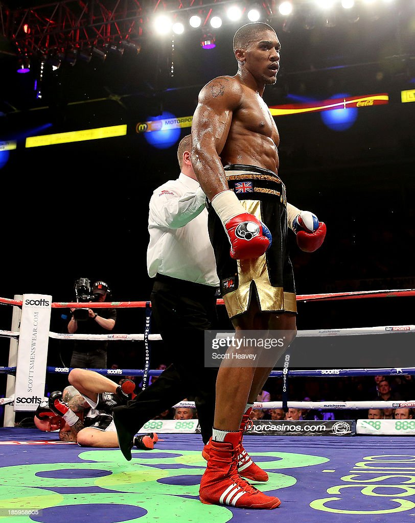 <a gi-track='captionPersonalityLinkClicked' href=/galleries/search?phrase=Anthony+Joshua&family=editorial&specificpeople=8598922 ng-click='$event.stopPropagation()'>Anthony Joshua</a> knocks out Paul Butlin during their Heavyweight bout at Motorpoint Arena on October 26, 2013 in Sheffield, England.