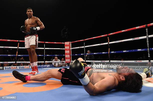 Anthony Joshua knocks out Raphael Zumbano Love during the Heavyweight Contest during Resurrection Fight Night at Barclaycard Arena on May 9 2015 in...