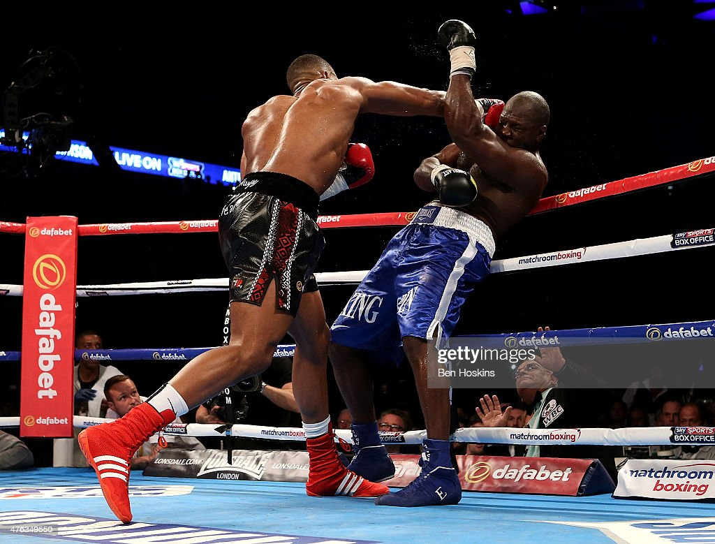 Anthony Joshua of England and Kevin Johnson of The USA exchange blows during their WBC International Heavyweight bout at The O2 Arena on May 30 2015...