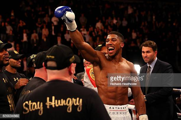 Anthony Joshua of England celebrates after defeating Charles Martin of the United States in action during the IBF World Heavyweight title fight at...