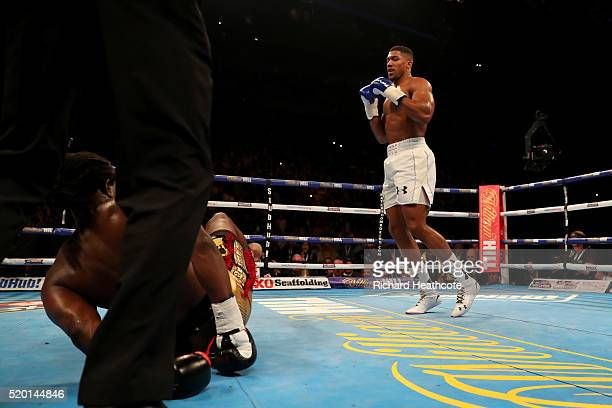 Anthony Joshua of England knocks Charles Martin of the United States to the canvas during the IBF World Heavyweight title fight at The O2 Arena on...