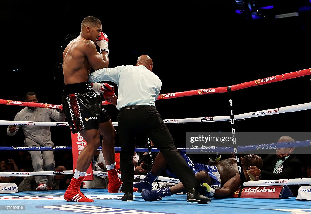 Anthony Joshua of England knocks down Kevin Johnson of The USA during their WBC International Heavyweight bout at The O2 Arena on May 30 2015 in...