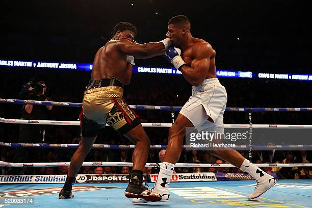 Anthony Joshua of England lands a punch that knocks Charles Martin of the United States to the canvas during the IBF World Heavyweight title fight at...