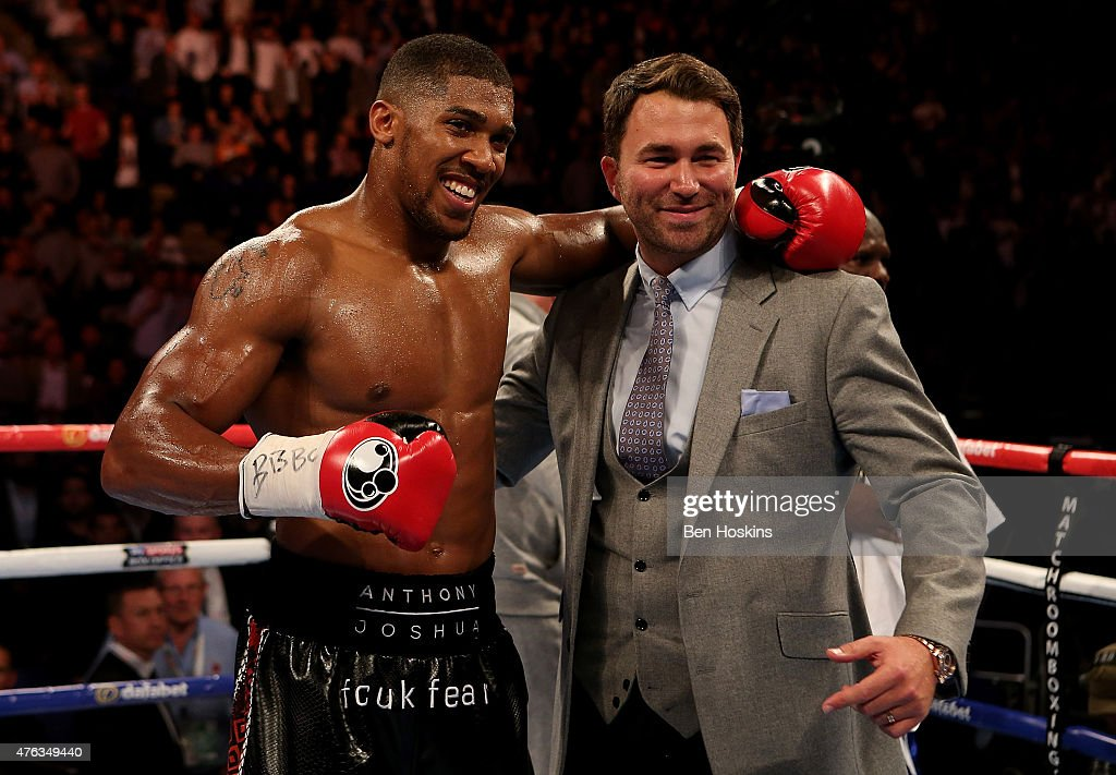 Anthony Joshua of England poses with Promoter Eddie Hearn following his WBC International Heavyweight bout against Kevin Johnson of The USA at The O2...