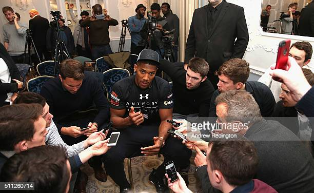 Anthony Joshua of England talks to the media during the Anthony Joshua and Charles Martin Press Conference at The Dorchester hotel on February 19...