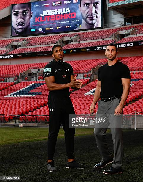 Anthony Joshua of Great Britain and Wladimir Klitschko of Ukraine pose following a press conference at Wembley Stadium on December 14 2016 in London...