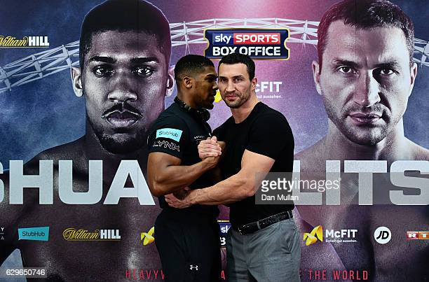 Anthony Joshua of Great Britain and Wladimir Klitschko of Ukraine shake hands during a press conference at Wembley Stadium on December 14 2016 in...