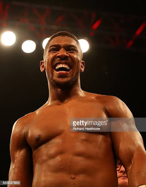 Anthony Joshua of Great Britain celebrates after defeating Dominic Breazeale of The USA during their IBF World Heavyweight Championship bout at The...