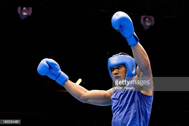 Anthony Joshua of Great Britain celebrates after fighting against Roberto Cammarelle of Italy during the Men's Super Heavy Boxing final bout on Day...