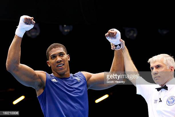 Anthony Joshua of Great Britain celebrates after the referee announces his victory against Roberto Cammarelle of Italy to win the Men's Super Heavy...