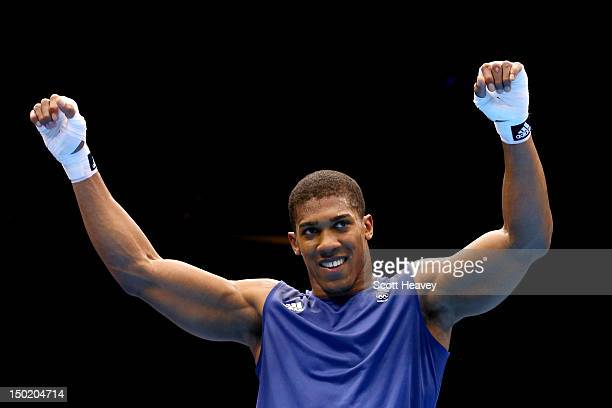 Anthony Joshua of Great Britain celebrates defeating Roberto Cammarelle of Italy to win the Men's Super Heavy Boxing final bout on Day 16 of the...