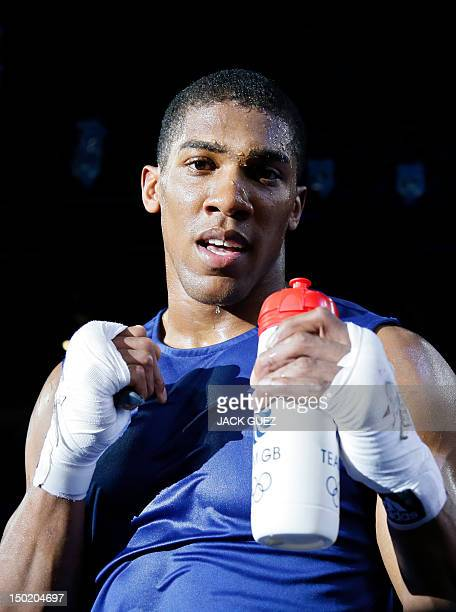 Anthony Joshua of Great Britain celebrates his gold medal victory over Roberto Cammarelle of Itay in the SuperHeavyweight boxing final of the 2012...