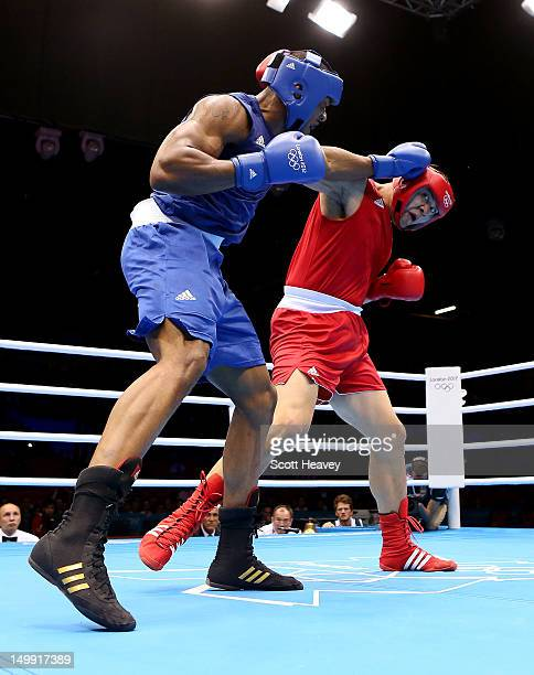 Anthony Joshua of Great Britain in action with Zhilei Zhang of China during the Men's Super Heavy on Day 10 of the London 2012 Olympic Games at ExCeL...