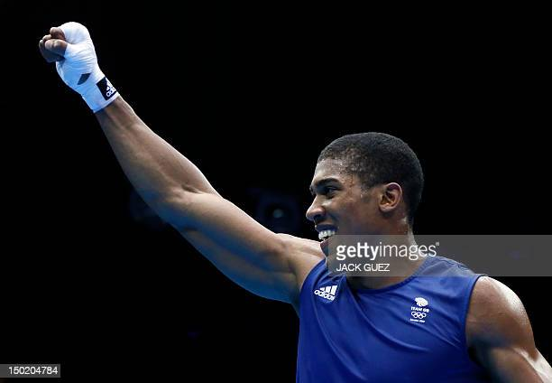 Anthony Joshua of Great Britain is declared gold medal winner over Roberto Cammarelle of Itay in the SuperHeavyweight boxing final of the 2012 London...