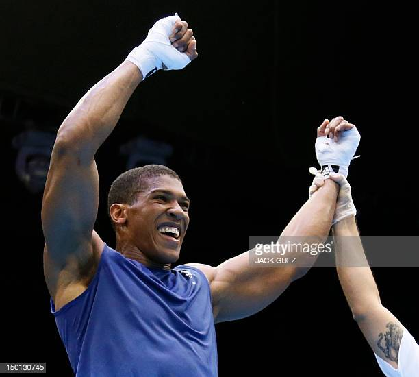 Anthony Joshua of Great Britain is declared victor over Ivan Dychko of Kazakhstan in the men's SuperHeavyweight boxing semifinals of the 2012 London...