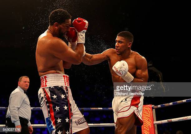 Anthony Joshua of Great Britain lands a punch on Dominic Breazeale of The USA during their IBF World Heavyweight Championship bout at The O2 Arena on...