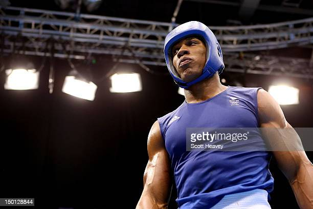 Anthony Joshua of Great Britain looks on against Ivan Dychko of Kazakhstan during their Men's Super Heavy Boxing semifinal bout on Day 14 of the...
