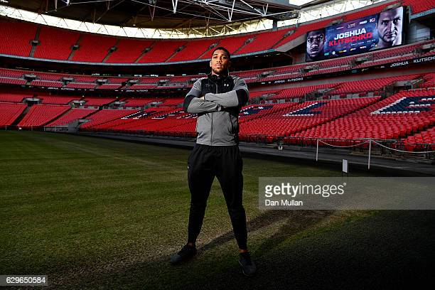 Anthony Joshua of Great Britain poses following a press conference at Wembley Stadium on December 14 2016 in London England