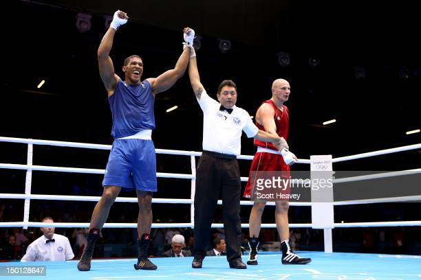 Anthony Joshua of Great Britain reacts after he was declared the winner against Ivan Dychko of Kazakhstan during their Men's Super Heavy Boxing...