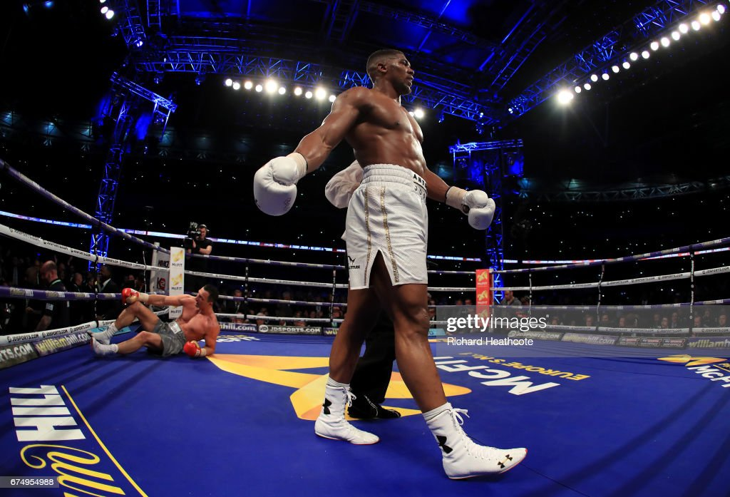 Anthony Joshua (White Shorts) puts Wladimir Klitschko (Grey Shorts) down in the 11th round during the IBF, WBA and IBO Heavyweight World Title bout at Wembley Stadium on April 29, 2017 in London, England.