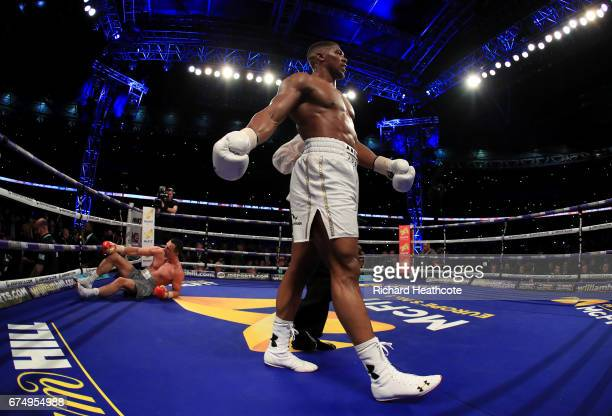 Anthony Joshua puts Wladimir Klitschko down in the 11th round during the IBF WBA and IBO Heavyweight World Title bout at Wembley Stadium on April 29...