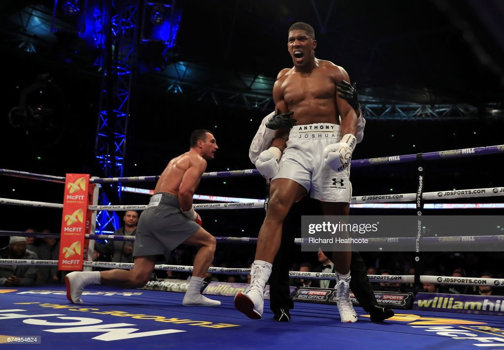 Anthony Joshua (White Shorts) puts Wladimir Klitschko (Grey Shorts) down in the 5th round during the IBF, WBA and IBO Heavyweight World Title bout at Wembley Stadium on April 29, 2017 in London, England.