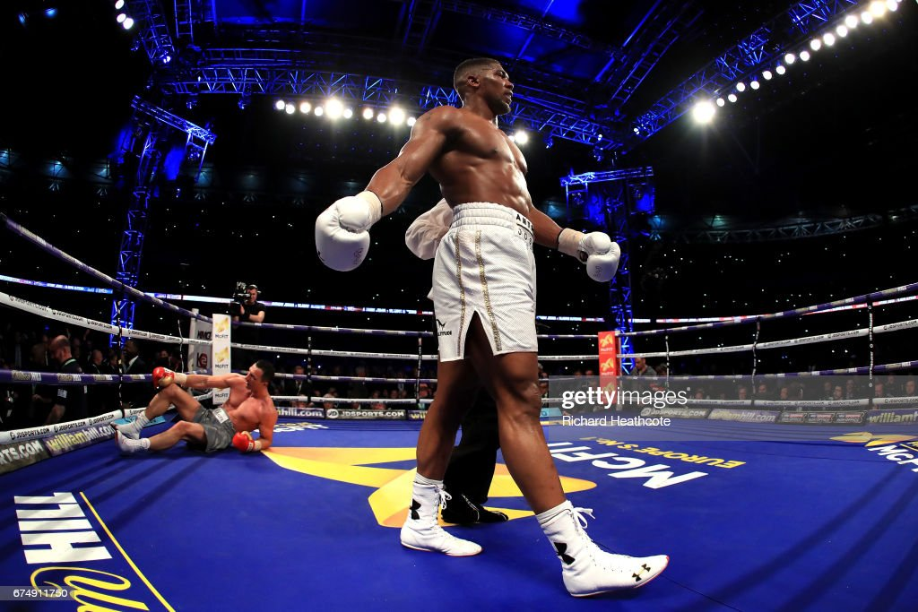 Anthony Joshua reacts after knocking down Wladimir Klitschko during the IBF, WBA and IBO Heavyweight World Title bout at Wembley Stadium on April 29, 2017 in London, England.