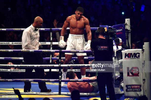 Anthony Joshua reacts after knocking down Wladimir Klitschko in the IBF WBA and IBO Heavyweight World Title bout at Wembley Stadium on April 29 2017...