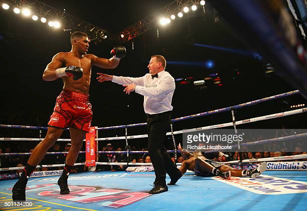 Anthony Joshua reacts as he knocks Dillian Whyte down in the seventh round during the British and Commonwealth heavyweight title contest at The O2...