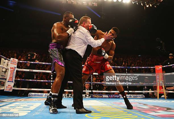 Anthony Joshua throws a punch after the bell at the end of the first round as the referee intervenes during the British and Commonwealth heavyweight...