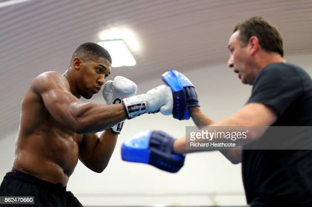 Anthony Joshua trains with trainer Robert McCracken during a media workout on October 17 2017 in Sheffield England