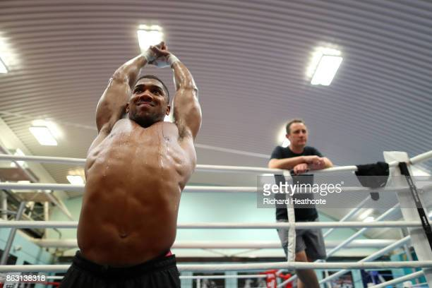 Anthony Joshua works out with his trainer Rob McCracken during a media workout at the English Institute of Sport on October 17 2017 in Sheffield...