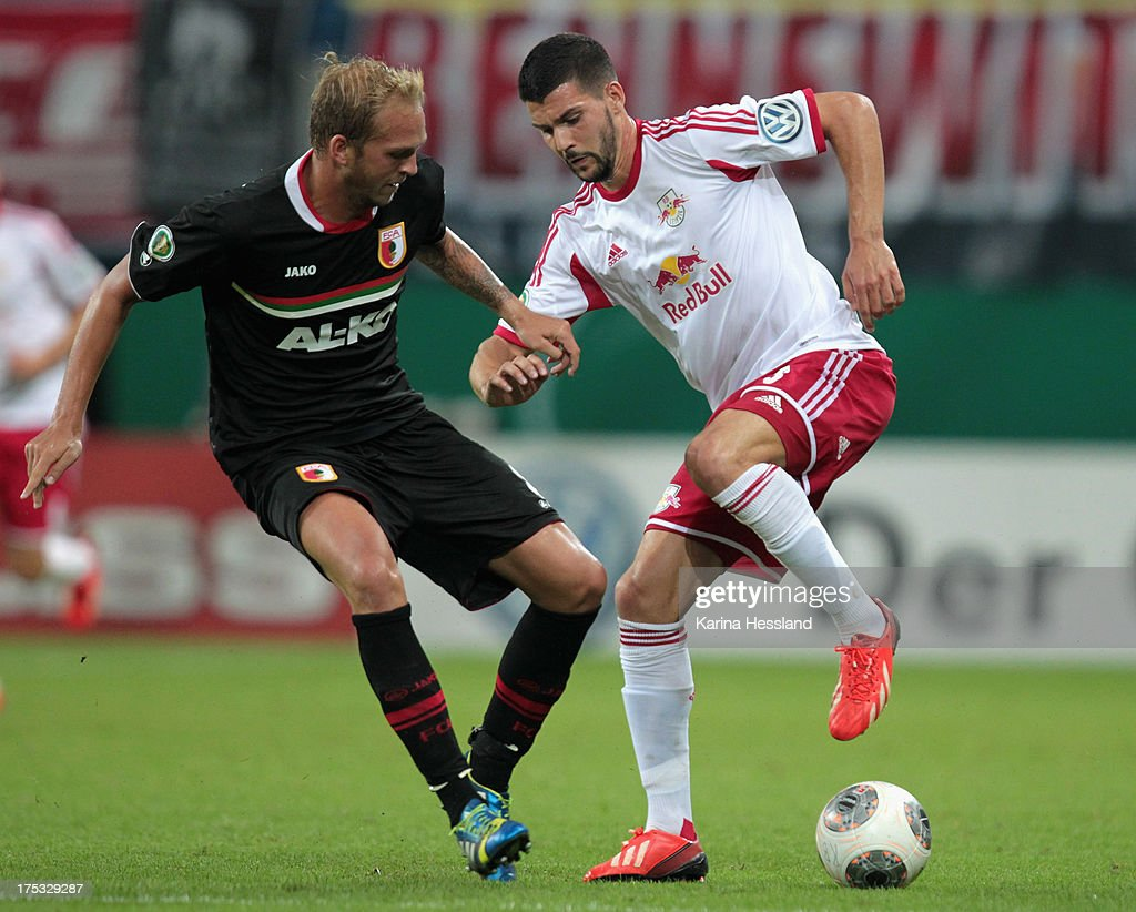 Anthony Jung of Leipzig and Raphael Holzhauser of Augsburg battle for the ball during the DFB-Cup between RB Leipzig and FC Augsburg at Zentralstadion on August 02, 2013 in Leipzig, Germany.